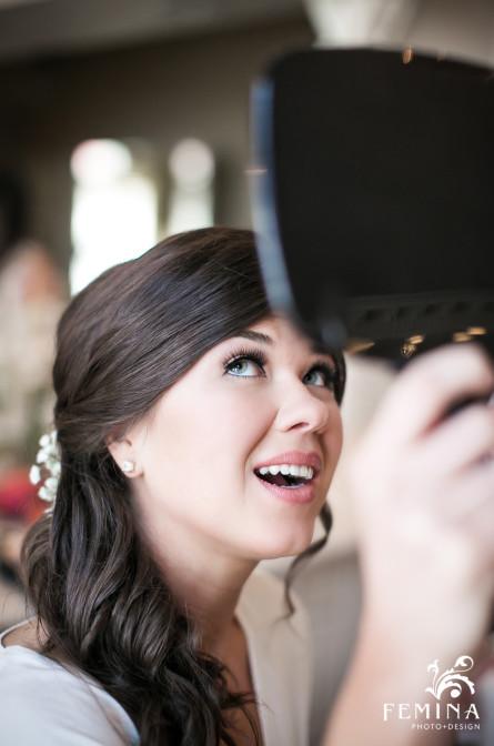 Bride Jackie looking into the mirror at Mallard Island Yacht Club