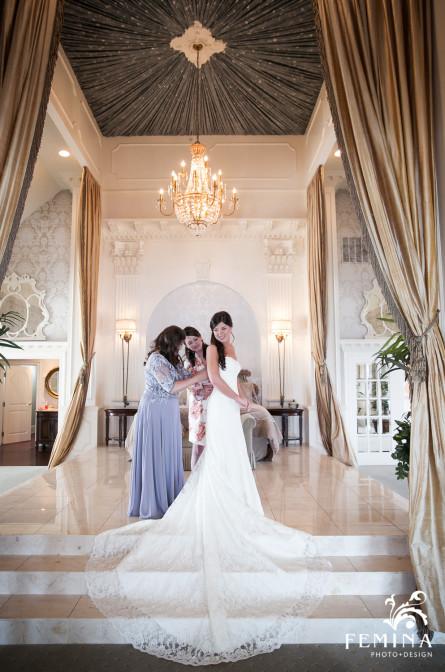 Bride getting dressed in the bridal suite at Mallard Island Yacht Club