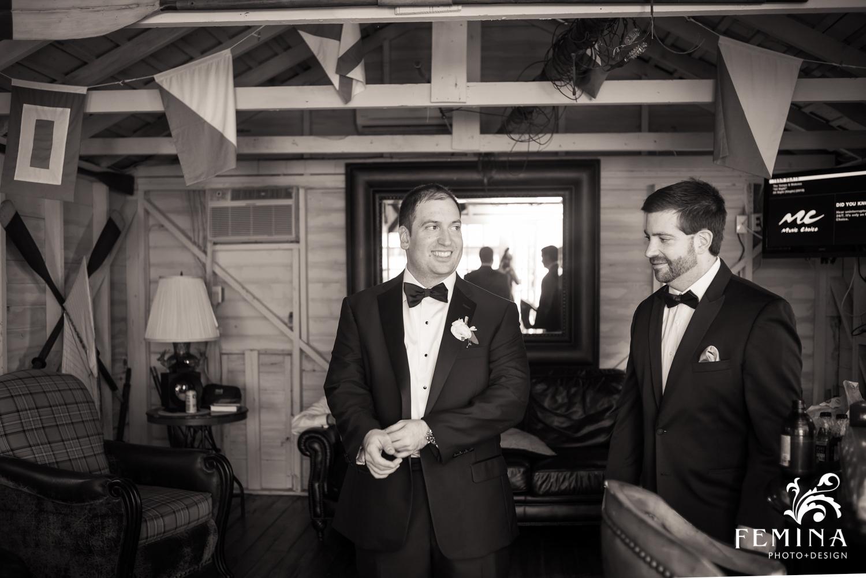 Matt getting ready in the groom's boathouse at Mallard Island Yacht Club