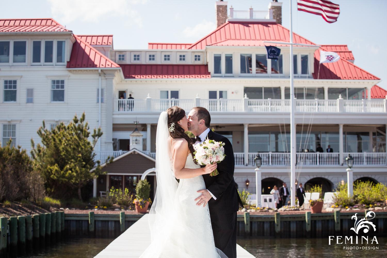 Jackie and Matt kissing on the dock at Mallard Island Yacht Club
