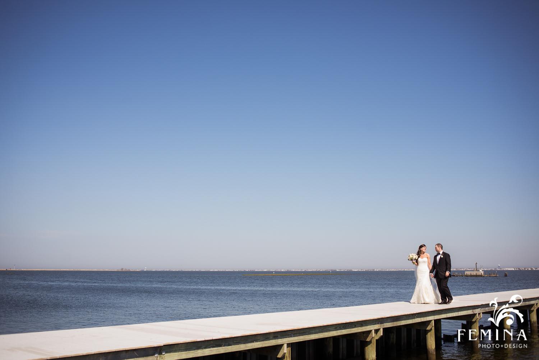 Jackie and Matt walking on the dock at Mallard Island Yacht Club
