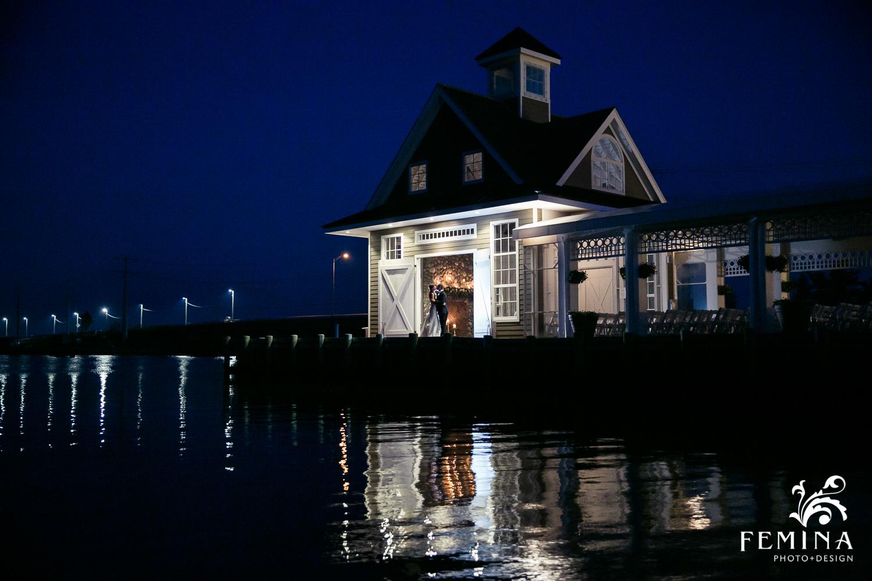 Boathouse Chapel Night Shot with bride and groom at Mallard Island Yacht Club