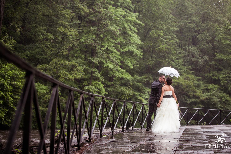 Marijela and Steven kiss under their umbrella