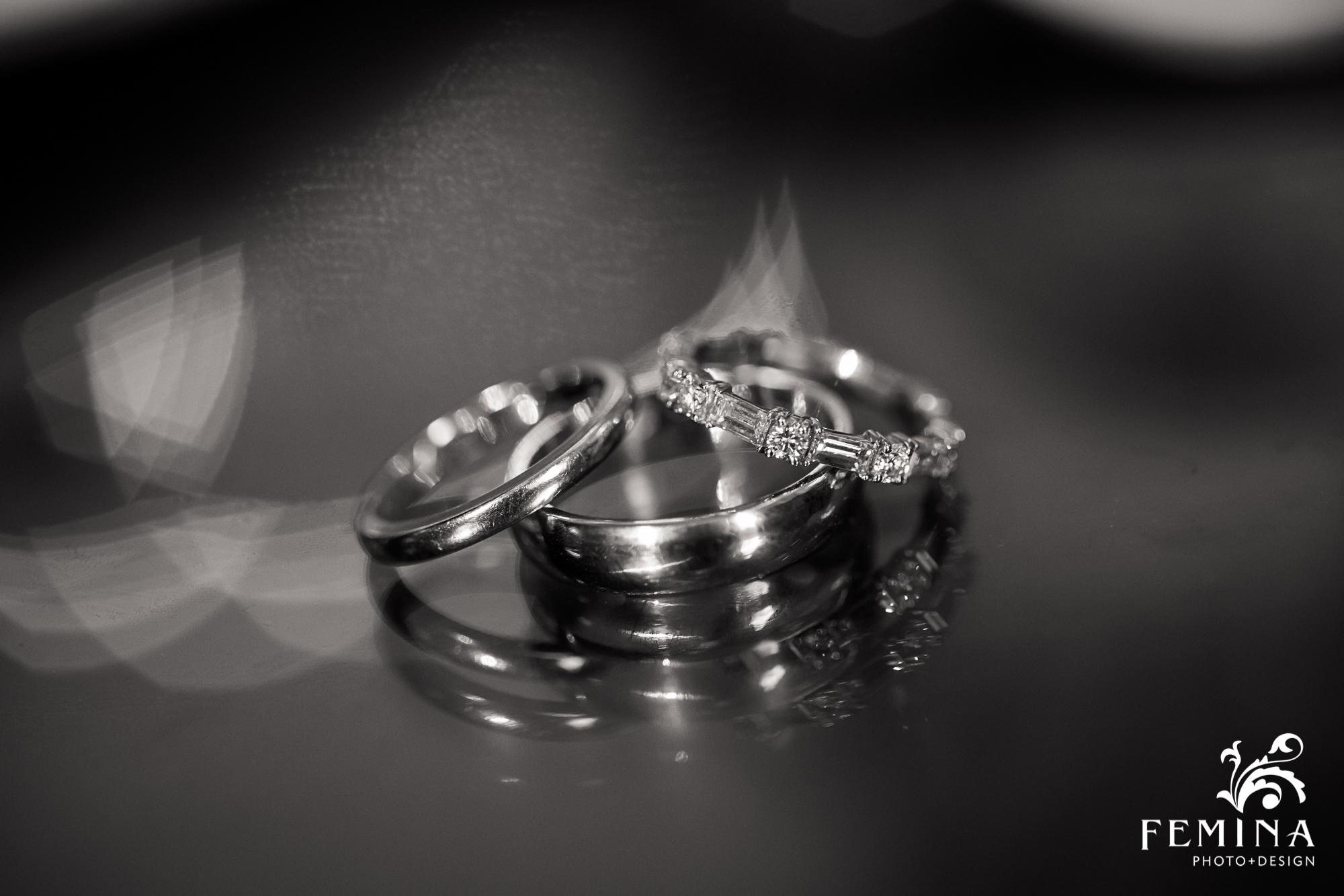 Wedding rings set upon a reflective table
