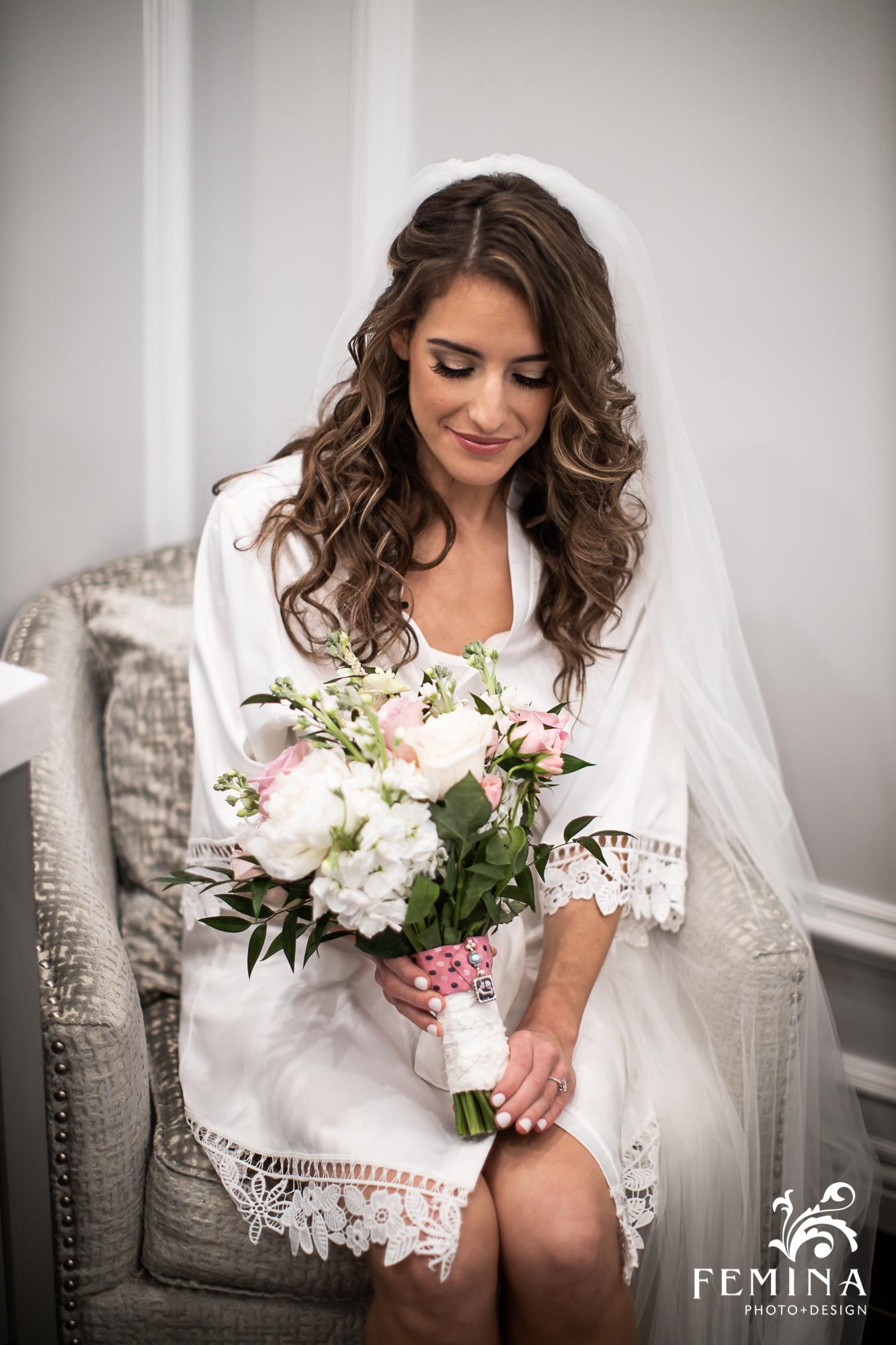 Bride Jamie admiring her bridal bouquet